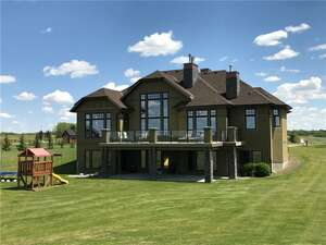 Featured Property in Cochrane, AB T4C 0B5