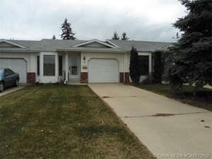 Featured Property in Lacombe, AB T4L 1N4