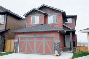 Featured Property in Cochrane, AB T4C 2A3