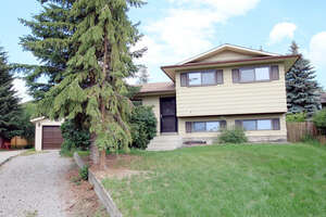 Featured Property in Cochrane, AB T4C 1C1