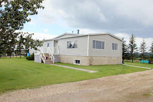 Featured Property in Cochrane, AB T4C 1A1