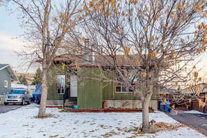 Featured Property in Cochrane, AB T4C 1C2