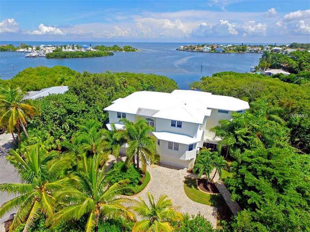 Home Listing at 8027 MARINA ISLES LANE, HOLMES BEACH, FL