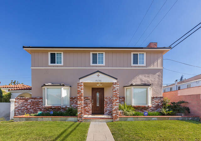 Single Family for Sale at 4136 S Bronson Avenue Los Angeles, California 90008 United States