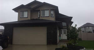 Featured Property in Lacombe, AB T4L 0G2
