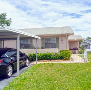Featured Property in Sun City Center, FL 33573