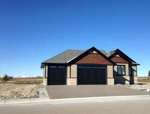 Featured Property in Cochrane, AB T4C 0G9