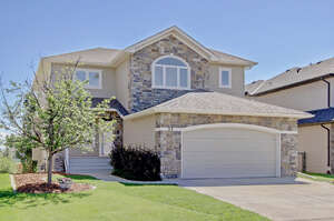 Featured Property in Okotoks, AB T1S 2N7
